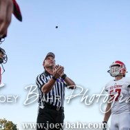 Team captains watch as the coin is tossed to decide who gets the ball first. The Great Bend Panthers defeated the Dodge City Demons 34 to 27 at Memorial Stadium in Great Bend, Kansas on September 23, 2016. (Photo: Joey Bahr, www.joeybahr.com)