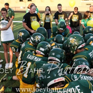 The Pratt Greenbacks kneel in prayer prior to running onto the field. The Hoisington Cardinals defeated the Pratt Greenbacks 32 to 14 at Zerger Field in Pratt, Kansas on September 30, 2016. (Photo: Joey Bahr, www.joeybahr.com)