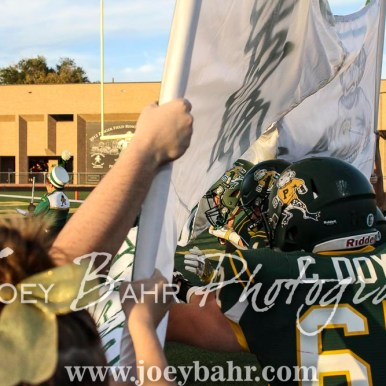 The Pratt Greenbacks run through a banner to take the field. The Hoisington Cardinals defeated the Pratt Greenbacks 32 to 14 at Zerger Field in Pratt, Kansas on September 30, 2016. (Photo: Joey Bahr, www.joeybahr.com)
