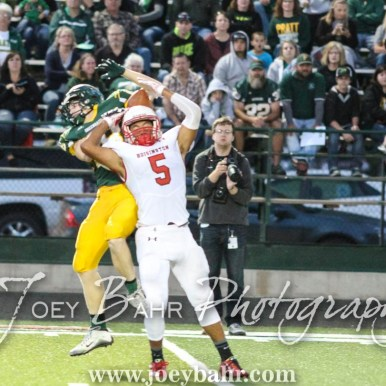 Hoisington Cardinal Cameron Davis (#5) breaks up a pass to Pratt Greenback Hunter Kaufman (#1). The Hoisington Cardinals defeated the Pratt Greenbacks 32 to 14 at Zerger Field in Pratt, Kansas on September 30, 2016. (Photo: Joey Bahr, www.joeybahr.com)