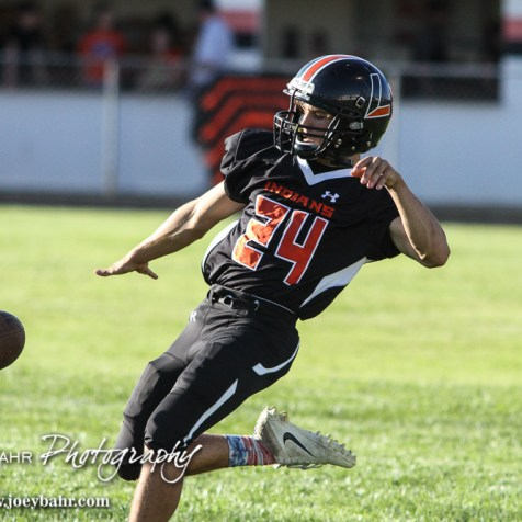 Larned Indian Dylan Koett (#24) practices a punt before the game. The Pratt Greenbacks win 31 to 16 over the Larned Indians at Earl Roberts Field in Larned, Kansas on September 2, 2016. (Photo: Joey Bahr, www.joeybahr.com)