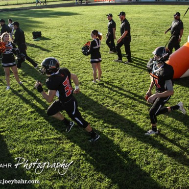 The Larned Indians run on to the field. The Pratt Greenbacks win 31 to 16 over the Larned Indians at Earl Roberts Field in Larned, Kansas on September 2, 2016. (Photo: Joey Bahr, www.joeybahr.com)