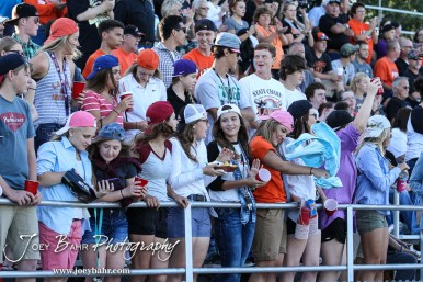 The Larned Pep Section cheers on as they dress up as Fraternity/Sorority members. The Pratt Greenbacks win 31 to 16 over the Larned Indians at Earl Roberts Field in Larned, Kansas on September 2, 2016. (Photo: Joey Bahr, www.joeybahr.com)