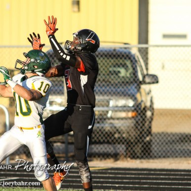 Pratt Greenback Noah Myers (#10) sets up in coverage in front of Larned Indian Damontay Phillips (#3). The Pratt Greenbacks win 31 to 16 over the Larned Indians at Earl Roberts Field in Larned, Kansas on September 2, 2016. (Photo: Joey Bahr, www.joeybahr.com)