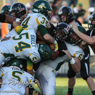 Pratt Greenbacks Cooper Doyle (#67), Logan Baird (#34), Jackson Bailey (#54), and Travis Theis (#5) all tackle Larned Indian Anthony McConnell (#1). The Pratt Greenbacks win 31 to 16 over the Larned Indians at Earl Roberts Field in Larned, Kansas on September 2, 2016. (Photo: Joey Bahr, www.joeybahr.com)