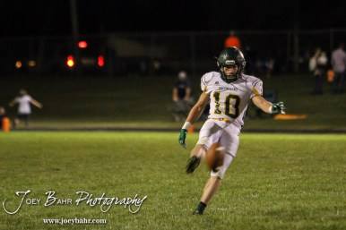 Pratt Greenback Noah Myers (#10) punts the ball away. The Pratt Greenbacks win 31 to 16 over the Larned Indians at Earl Roberts Field in Larned, Kansas on September 2, 2016. (Photo: Joey Bahr, www.joeybahr.com)