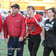 Great Bend Panther Cory Burnham (#28) is introduced along with his parents during the Parents Night Ceremony before the game. The Garden City Buffaloes defeated the Great Bend Panthers 21 to 14 in Overtime to win the Western Athletic Conference title at Memorial Stadium in Great Bend, Kansas on October 21, 2016. (Photo: Joey Bahr, www.joeybahr.com)