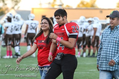 Great Bend Panther Hector Olivas (#24) is introduced along with his parents during the Parents Night Ceremony before the game. The Garden City Buffaloes defeated the Great Bend Panthers 21 to 14 in Overtime to win the Western Athletic Conference title at Memorial Stadium in Great Bend, Kansas on October 21, 2016. (Photo: Joey Bahr, www.joeybahr.com)