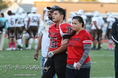 Great Bend Panther Braulio Vargas (#36) is introduced along with his parents during the Parents Night Ceremony before the game. The Garden City Buffaloes defeated the Great Bend Panthers 21 to 14 in Overtime to win the Western Athletic Conference title at Memorial Stadium in Great Bend, Kansas on October 21, 2016. (Photo: Joey Bahr, www.joeybahr.com)