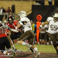 Great Bend Panther Braulio Vargas (#36) dives low to try and trip up Garden City Buffalo Peyton Hill (#34). The Garden City Buffaloes defeated the Great Bend Panthers 21 to 14 in Overtime to win the Western Athletic Conference title at Memorial Stadium in Great Bend, Kansas on October 21, 2016. (Photo: Joey Bahr, www.joeybahr.com)