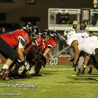 Both lines move after the ball is hiked. The Garden City Buffaloes defeated the Great Bend Panthers 21 to 14 in Overtime to win the Western Athletic Conference title at Memorial Stadium in Great Bend, Kansas on October 21, 2016. (Photo: Joey Bahr, www.joeybahr.com)