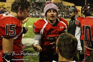 Great Bend Panther Payton Mauler (#32) talks to his teammates on the sideline after being diagnosed with a concussion. The Garden City Buffaloes defeated the Great Bend Panthers 21 to 14 in Overtime to win the Western Athletic Conference title at Memorial Stadium in Great Bend, Kansas on October 21, 2016. (Photo: Joey Bahr, www.joeybahr.com)