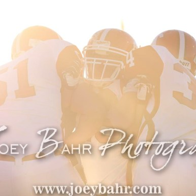 Three Greeley County Jackrabbits warm up in the setting sun. The Otis-Bison Cougars defeated the Greeley County Jackrabbits 62 to 6 at Cougar Field in Otis, Kansas on October 7, 2016. (Photo: Joey Bahr, www.joeybahr.com)