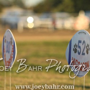 Football signs with the Otis-Bison player names are set on the side of the field. The Otis-Bison Cougars defeated the Greeley County Jackrabbits 62 to 6 at Cougar Field in Otis, Kansas on October 7, 2016. (Photo: Joey Bahr, www.joeybahr.com)