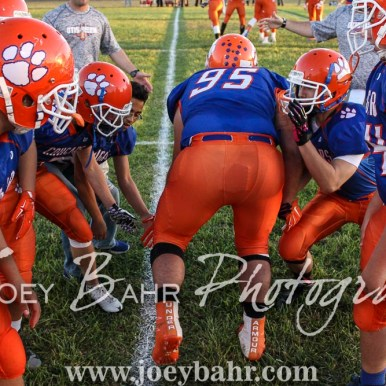 Otis-Bison Cougar Bryce Maneth (#95) greets teammates during player introductions. The Otis-Bison Cougars defeated the Greeley County Jackrabbits 62 to 6 at Cougar Field in Otis, Kansas on October 7, 2016. (Photo: Joey Bahr, www.joeybahr.com)