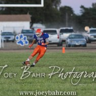 Otis-Bison Cougar Seth Hoopingarner (#80) kicks off the ball after a touchdown. The Otis-Bison Cougars defeated the Greeley County Jackrabbits 62 to 6 at Cougar Field in Otis, Kansas on October 7, 2016. (Photo: Joey Bahr, www.joeybahr.com)