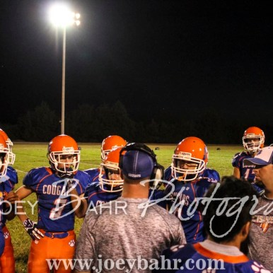 Otis-Bison Cougar Head Coach Travis Starr talks to his Defense during a timeout. The Otis-Bison Cougars defeated the Greeley County Jackrabbits 62 to 6 at Cougar Field in Otis, Kansas on October 7, 2016. (Photo: Joey Bahr, www.joeybahr.com)