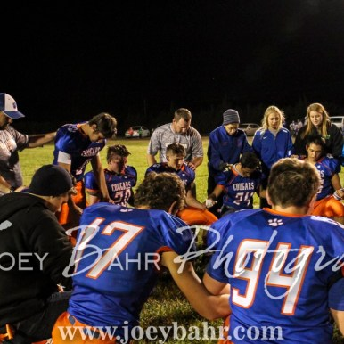 Members of the Otis-Bison Cougars gather to pray following the game. The Otis-Bison Cougars defeated the Greeley County Jackrabbits 62 to 6 at Cougar Field in Otis, Kansas on October 7, 2016. (Photo: Joey Bahr, www.joeybahr.com)