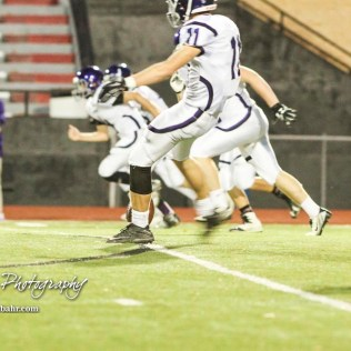 Topeka West Charger Elliot Mehrens (#11) kicks off the ball to start the game. The Great Bend Panthers defeated the Topeka West Chargers 70 to 31 in a KSHSAA Class 5A First Round matchup. at Memorial Stadium in Great Bend, Kansas on October 28, 2016. (Photo: Joey Bahr, www.joeybahr.com)
