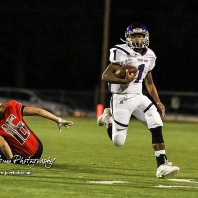 Topeka West Charger Brian Wright (#1) runs past Great Bend Panther Dalton Miller (#16). The Great Bend Panthers defeated the Topeka West Chargers 70 to 31 in a KSHSAA Class 5A First Round matchup. at Memorial Stadium in Great Bend, Kansas on October 28, 2016. (Photo: Joey Bahr, www.joeybahr.com)