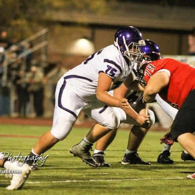 Topeka West Charger Blake Hartke (#75) moves to block Great Bend Panther Koby Schroeder (#79). The Great Bend Panthers defeated the Topeka West Chargers 70 to 31 in a KSHSAA Class 5A First Round matchup. at Memorial Stadium in Great Bend, Kansas on October 28, 2016. (Photo: Joey Bahr, www.joeybahr.com)
