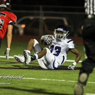 Topeka West Charger Chris Ellis (#13) lands in the end zone to score a touchdown as Great Bend Panther Dalton Miller (#16) covers. The Great Bend Panthers defeated the Topeka West Chargers 70 to 31 in a KSHSAA Class 5A First Round matchup. at Memorial Stadium in Great Bend, Kansas on October 28, 2016. (Photo: Joey Bahr, www.joeybahr.com)