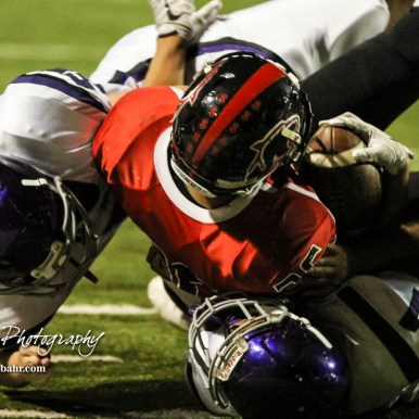 Topeka West Chargers Brian Wright (#1) and Kevin Link (#55) tackle Great Bend Panther Braulio Vargas (#36). The Great Bend Panthers defeated the Topeka West Chargers 70 to 31 in a KSHSAA Class 5A First Round matchup. at Memorial Stadium in Great Bend, Kansas on October 28, 2016. (Photo: Joey Bahr, www.joeybahr.com)