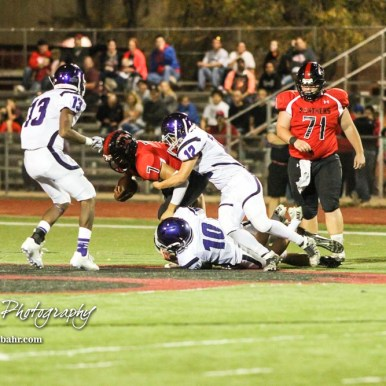 Topeka West Chargers Zach Shima (#10) and TJ Peterson (#12) tackle Great Bend Panther Jacob Murray (#7). The Great Bend Panthers defeated the Topeka West Chargers 70 to 31 in a KSHSAA Class 5A First Round matchup. at Memorial Stadium in Great Bend, Kansas on October 28, 2016. (Photo: Joey Bahr, www.joeybahr.com)