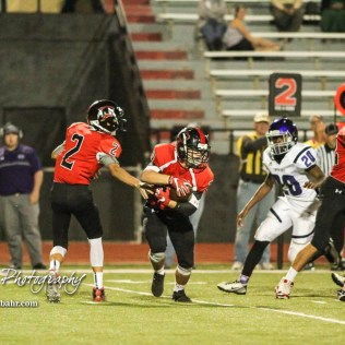Great Bend Panther Ty Esfeld (#2) hands the ball off to Gage Fritz (#29). The Great Bend Panthers defeated the Topeka West Chargers 70 to 31 in a KSHSAA Class 5A First Round matchup. at Memorial Stadium in Great Bend, Kansas on October 28, 2016. (Photo: Joey Bahr, www.joeybahr.com)