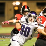 Topeka West Charger Vincent Parker (#80) reaches out to try and tackle Great Bend Panther Gage Fritz (#29). The Great Bend Panthers defeated the Topeka West Chargers 70 to 31 in a KSHSAA Class 5A First Round matchup. at Memorial Stadium in Great Bend, Kansas on October 28, 2016. (Photo: Joey Bahr, www.joeybahr.com)