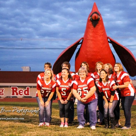 The Hoisington Cardinal Senior Mothers pose in front of the large Cardinal by the East end zone prior to the game. The Hoisington Cardinals defeated the Lakin Broncs in the KSHSAA Class 3A Bi-District game with a score of 56 to 13 at Elton Brown Field in Hoisington, Kansas on November 1, 2016. (Photo: Joey Bahr, www.joeybahr.com)