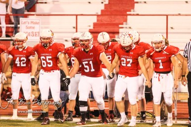 Hoisington Cardinal Team Captains Ben Schneider (#65), Landen Urban (#51), Hunter Hanzlick (#27), and Tyler Specht (#1) walk to the center of the field for the coin toss. The Hoisington Cardinals defeated the Lakin Broncs in the KSHSAA Class 3A Bi-District game with a score of 56 to 13 at Elton Brown Field in Hoisington, Kansas on November 1, 2016. (Photo: Joey Bahr, www.joeybahr.com)
