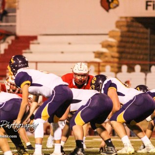Hoisington Cardinal Hunter Hanzlick (#27) watches the Quarterback over the Lakin Bronc offensive line. The Hoisington Cardinals defeated the Lakin Broncs in the KSHSAA Class 3A Bi-District game with a score of 56 to 13 at Elton Brown Field in Hoisington, Kansas on November 1, 2016. (Photo: Joey Bahr, www.joeybahr.com)