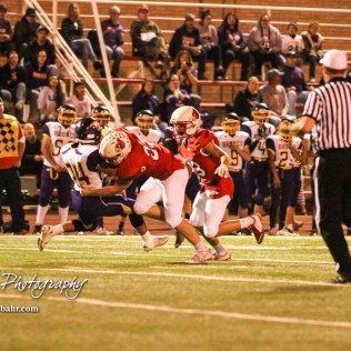 Hoisington Cardinal Hunter Hanzlick (#27) blocks Lakin Bronc Johnney Perez (#24) as Sean Urban (#23) runs by. The Hoisington Cardinals defeated the Lakin Broncs in the KSHSAA Class 3A Bi-District game with a score of 56 to 13 at Elton Brown Field in Hoisington, Kansas on November 1, 2016. (Photo: Joey Bahr, www.joeybahr.com)