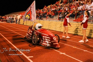 An electric car carries the Hoisington Cardinal flag after a touchdown is scored. The Hoisington Cardinals defeated the Lakin Broncs in the KSHSAA Class 3A Bi-District game with a score of 56 to 13 at Elton Brown Field in Hoisington, Kansas on November 1, 2016. (Photo: Joey Bahr, www.joeybahr.com)