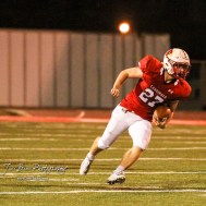Hoisington Cardinal Hunter Hanzlick (#27) rushes with the ball. The Hoisington Cardinals defeated the Lakin Broncs in the KSHSAA Class 3A Bi-District game with a score of 56 to 13 at Elton Brown Field in Hoisington, Kansas on November 1, 2016. (Photo: Joey Bahr, www.joeybahr.com)