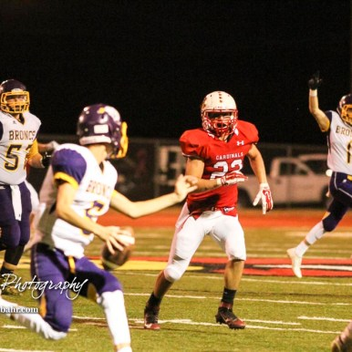 Hoisington Cardinal Jared Curtis (#22) tracks Lakin Bronc Hunter Kirby (#5). The Hoisington Cardinals defeated the Lakin Broncs in the KSHSAA Class 3A Bi-District game with a score of 56 to 13 at Elton Brown Field in Hoisington, Kansas on November 1, 2016. (Photo: Joey Bahr, www.joeybahr.com)