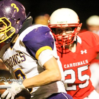 Lakin Bronc Jeff Gilleland (#3) runs past Hoisington Cardinal Dante Urban (#25). The Hoisington Cardinals defeated the Lakin Broncs in the KSHSAA Class 3A Bi-District game with a score of 56 to 13 at Elton Brown Field in Hoisington, Kansas on November 1, 2016. (Photo: Joey Bahr, www.joeybahr.com)