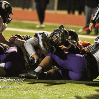 Valley Center Hornet Josh Roeser (#7) rides the pile into the end zone to score a touchdown. The Great Bend Panthers defeated the Valley Center Hornets to win the KSHSAA Class 5A Sectional by a score of 28 to 24 at Memorial Field in Great Bend, Kansas on November 11, 2016. (Photo: Joey Bahr, www.joeybahr.com)