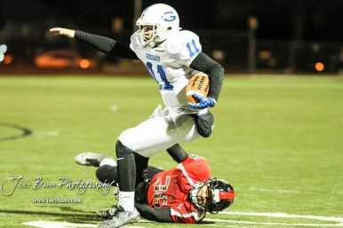 Goddard Lion Blake Sullivan (#11) avoids the tackle of Great Bend Panther Braulio Vargas (#36). The Goddard Lions defeated the Great Bend Panthers to win the KSHSAA Class 5A Sub-State Championship by a score of 50 to 21 at Memorial Field in Great Bend, Kansas on November 18, 2016. (Photo: Joey Bahr, www.joeybahr.com)