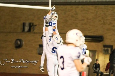 Goddard Lion AJ Vang (#51) lifts up Bryant Mocaby (#87) after he scored a touchdown. The Goddard Lions defeated the Great Bend Panthers to win the KSHSAA Class 5A Sub-State Championship by a score of 50 to 21 at Memorial Field in Great Bend, Kansas on November 18, 2016. (Photo: Joey Bahr, www.joeybahr.com)