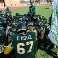 Members of the Pratt Greenbacks kneel in prayer prior to the start of the game. The Pratt Greenbacks defeated the Hayden Wildcats 48 to 14 to win the KSHSAA Class 4A Division II State Championship Game at Salina Stadium in Salina, Kansas on November 26, 2016. (Photo: Joey Bahr, www.joeybahr.com)