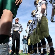 Team captains gather for the coin toss prior to the game. The Pratt Greenbacks defeated the Hayden Wildcats 48 to 14 to win the KSHSAA Class 4A Division II State Championship Game at Salina Stadium in Salina, Kansas on November 26, 2016. (Photo: Joey Bahr, www.joeybahr.com)