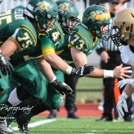 The Pratt Greenback offensive line fires off the ball. The Pratt Greenbacks defeated the Hayden Wildcats 48 to 14 to win the KSHSAA Class 4A Division II State Championship Game at Salina Stadium in Salina, Kansas on November 26, 2016. (Photo: Joey Bahr, www.joeybahr.com)