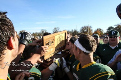 Pratt Greenback Hunter Huber (#40) kisses the State Championship Trophy. The Pratt Greenbacks defeated the Hayden Wildcats 48 to 14 to win the KSHSAA Class 4A Division II State Championship Game at Salina Stadium in Salina, Kansas on November 26, 2016. (Photo: Joey Bahr, www.joeybahr.com)