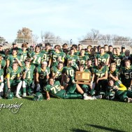 The Pratt Greenbacks pose for a picture with the State Championship Trophy. The Pratt Greenbacks defeated the Hayden Wildcats 48 to 14 to win the KSHSAA Class 4A Division II State Championship Game at Salina Stadium in Salina, Kansas on November 26, 2016. (Photo: Joey Bahr, www.joeybahr.com)