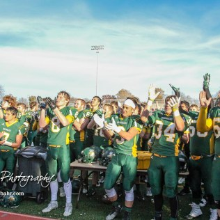 "Members of the Pratt Greenbacks sing ""If You are Happy and You Know It"" to their supporters. The Pratt Greenbacks defeated the Hayden Wildcats 48 to 14 to win the KSHSAA Class 4A Division II State Championship Game at Salina Stadium in Salina, Kansas on November 26, 2016. (Photo: Joey Bahr, www.joeybahr.com)"