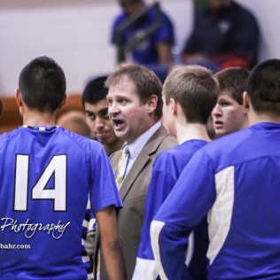 St. John Tiger Head Coach Clint Kinnamon addresses his players during a timeout. The St. John Tigers defeated the Central Plains Oilers by a score of 62 to 31 at Central Plains High School in Claflin, Kansas on December 13, 2016. (Photo: Joey Bahr, www.joeybahr.com)