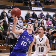 St. John Tiger #10 Cole Kinnamon drives past Central Plains Oiler #10 Bryce Miller to the basket. The St. John Tigers defeated the Central Plains Oilers by a score of 62 to 31 at Central Plains High School in Claflin, Kansas on December 13, 2016. (Photo: Joey Bahr, www.joeybahr.com)