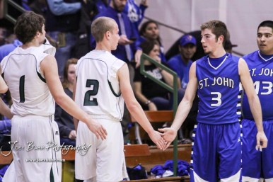 Members of the Central Plains Oilers and St. John Tigers shake hands following the game. The St. John Tigers defeated the Central Plains Oilers by a score of 62 to 31 at Central Plains High School in Claflin, Kansas on December 13, 2016. (Photo: Joey Bahr, www.joeybahr.com)